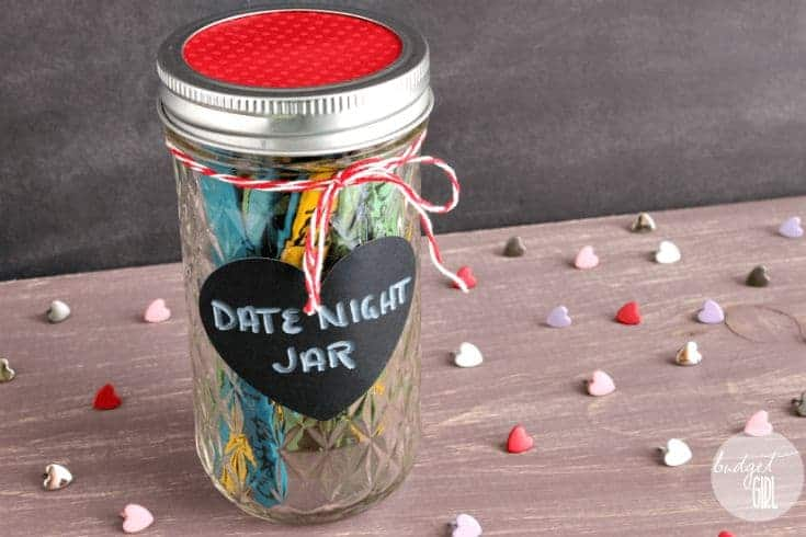 dyed popsicle sticks in a jar with a label date night jar