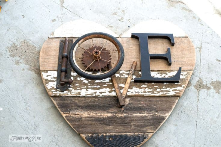 wooden sign in a heart shape with love word made out of scraps