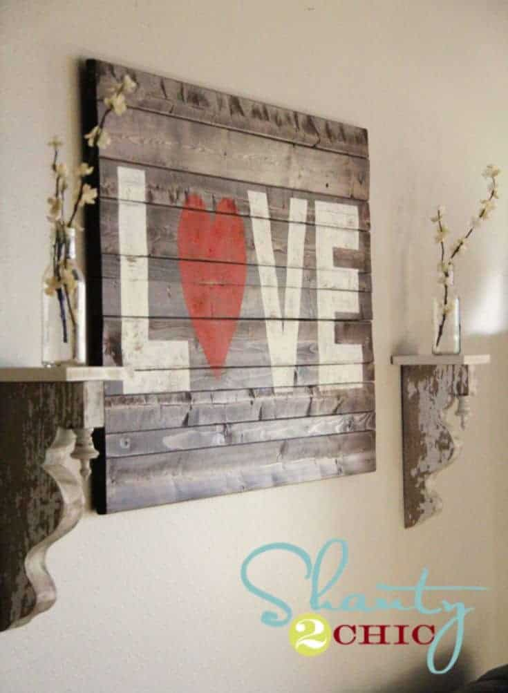 wooden sign with a word love hanged on the wall